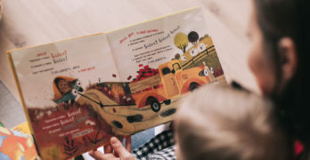 Mother Reading To Her Baby | 5 Tips On Finding A Babysitter You Can Trust