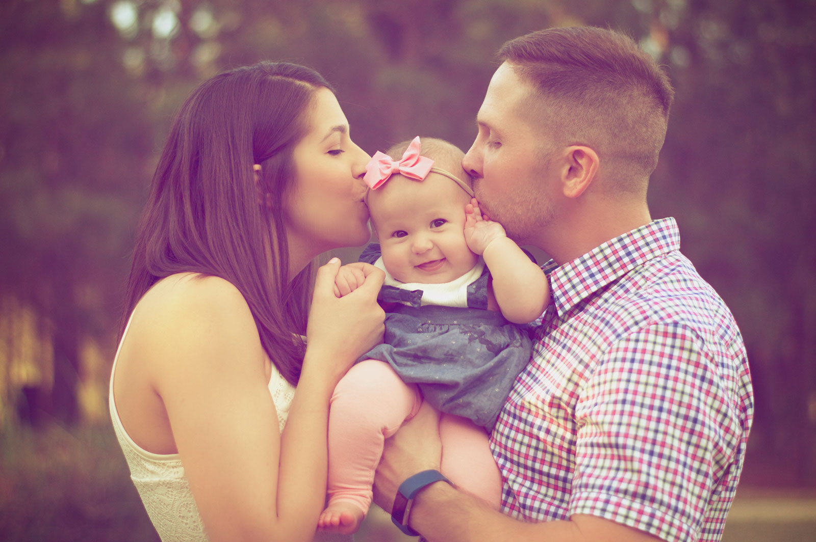 Parents Kissing Baby | 8 Ways To Still Have A Life After Having A New Baby