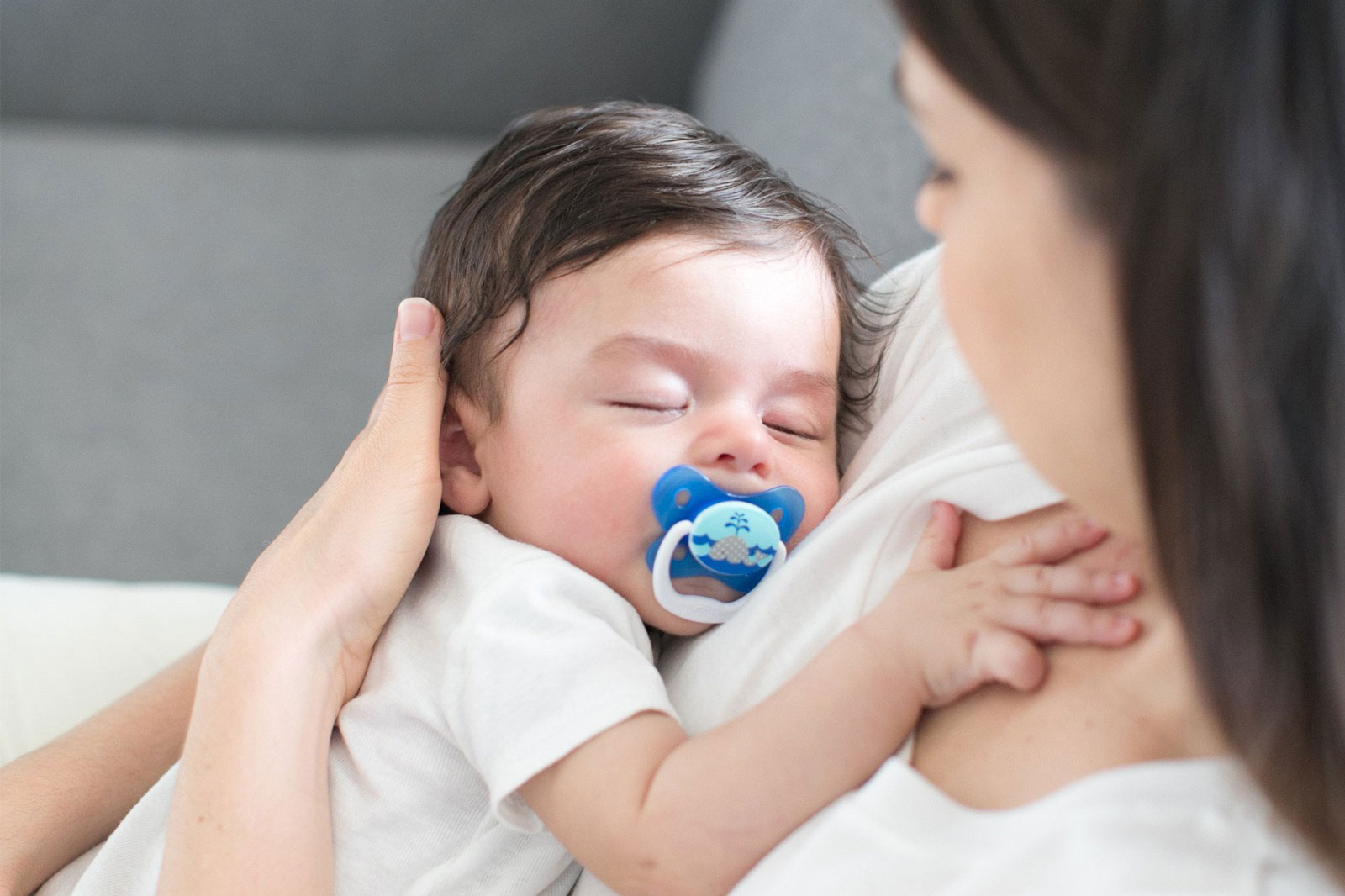 Mother Holding Her Baby With Pacifier   #MomLife: 25 Things Only New Moms Can Fully Understand