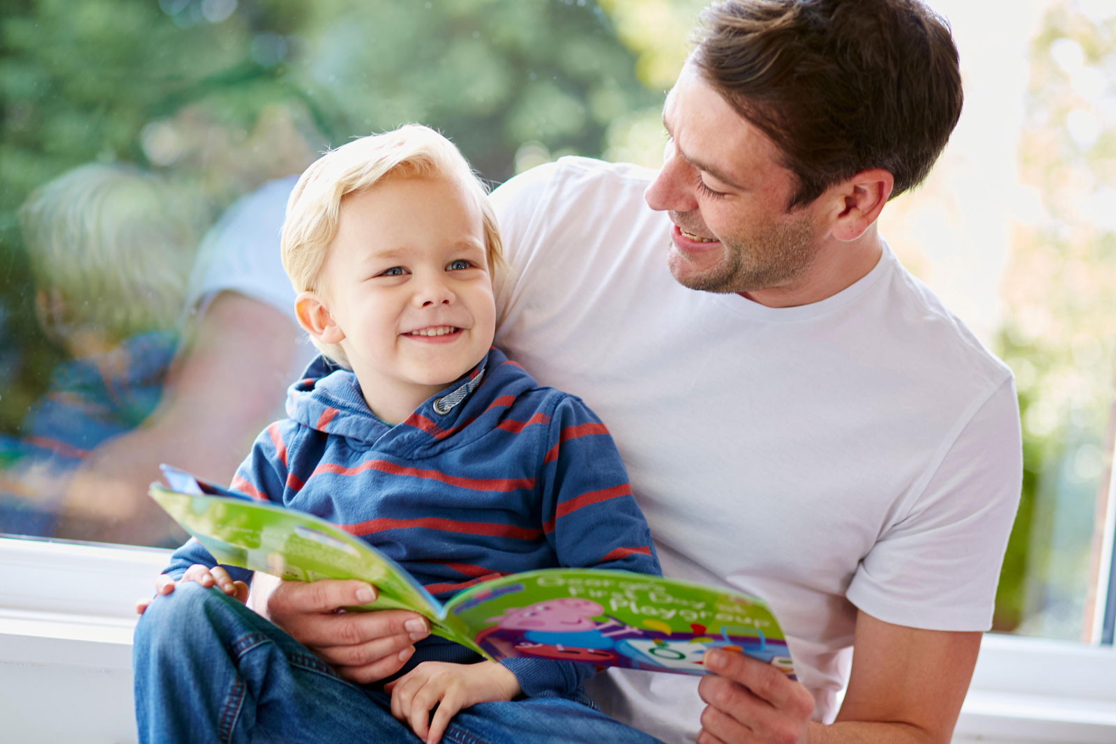 Father and Son Reading a Book | The 10 Best Books For First Time Parents To Read