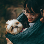 Woman With Dog | What To Do If Your Dog Is Jealous Of Your New Baby